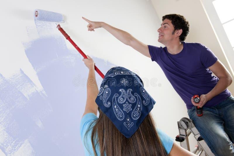 Het schilderen van het Nieuwe Huis stock afbeelding