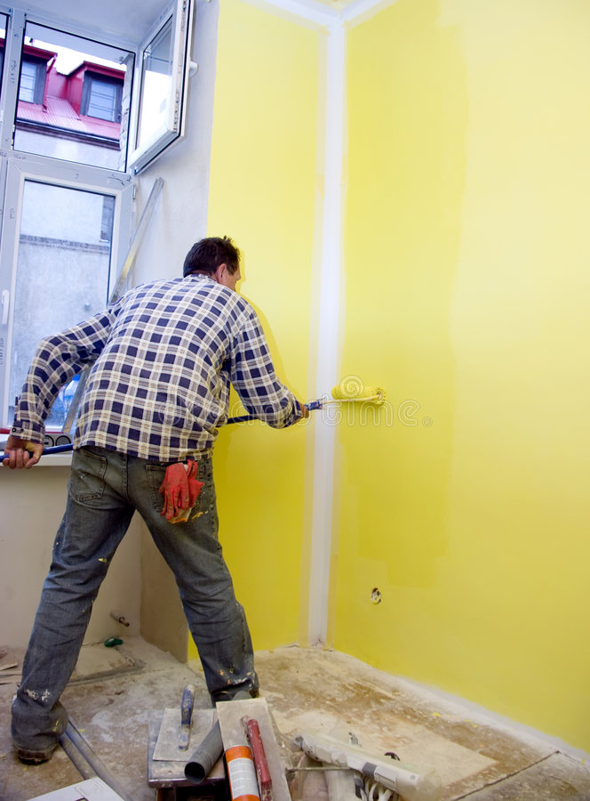Het schilderen van ruimte in geel stock foto's