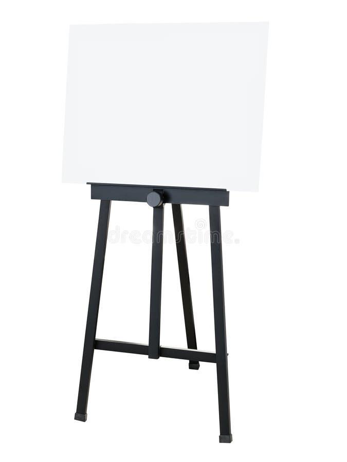 Het schilderen van tribune Zwarte schildersezel met leeg canvas stock foto's