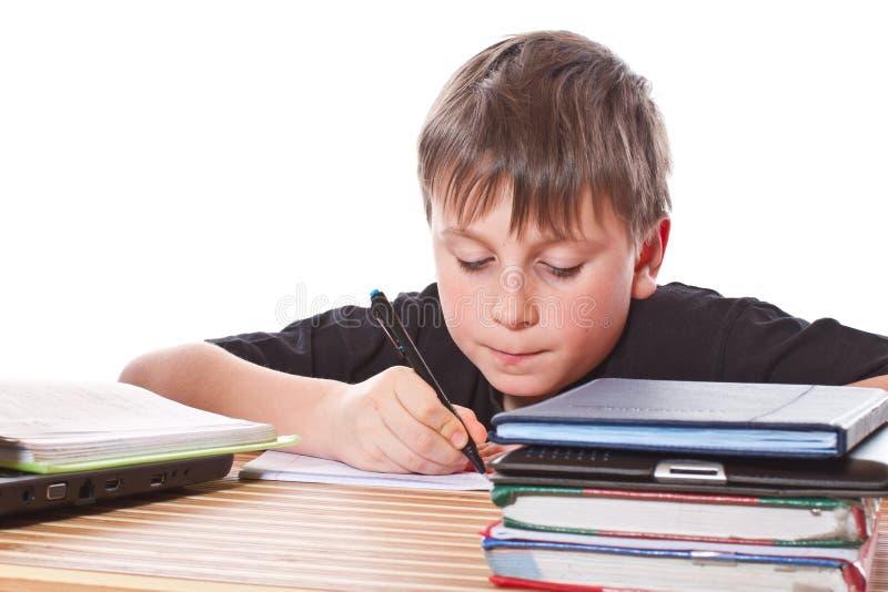 Het schoolkind leert lessen stock fotografie