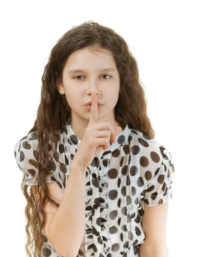 Het schoolmeisje zet vinger aan lippen royalty-vrije stock afbeeldingen