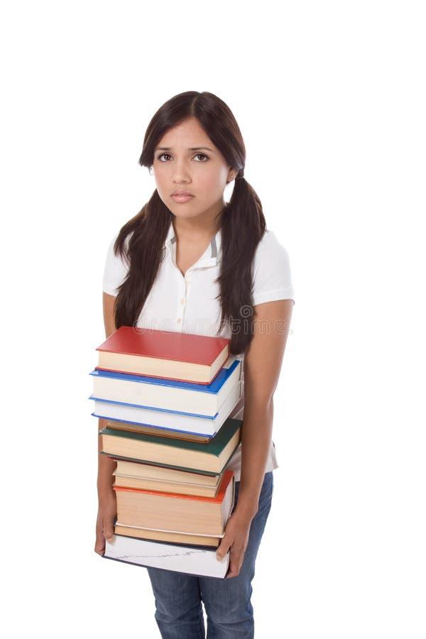 Het schoolmeisjestudent van de middelbare school met stapelboeken stock afbeeldingen