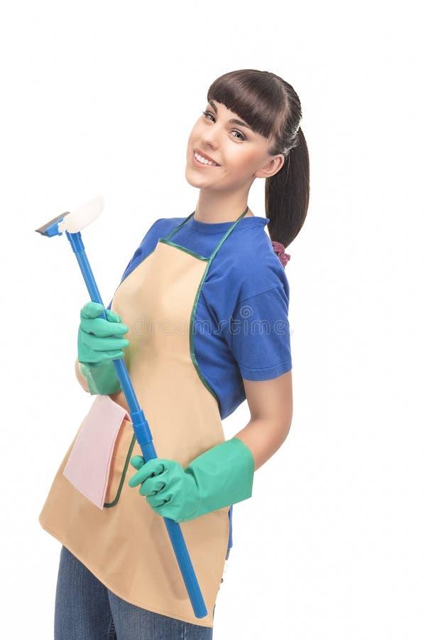 Het schoonmaken Concept: Gelukkige Kaukasische Vrouwelijke Holdings Rubberschraper stock afbeeldingen