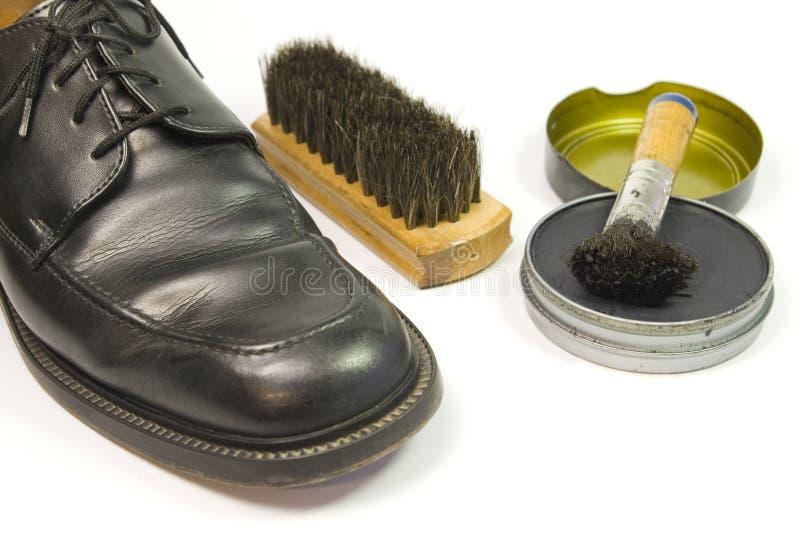 Het schoonmaken van de schoen reeks royalty-vrije stock afbeeldingen