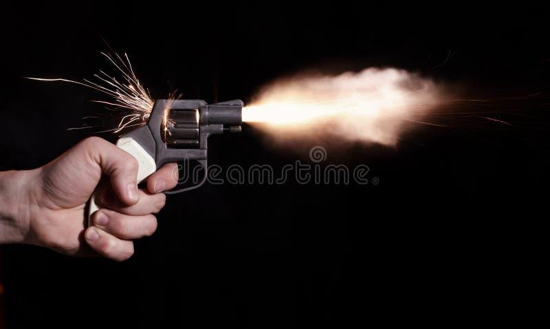 Het schot van het pistool stock afbeelding