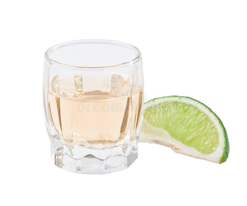 Het schot van Tequila dat op wit wordt geïsoleerdn stock foto
