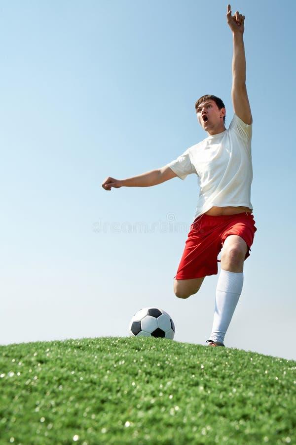 Het schreeuwen van de voetballer stock afbeelding