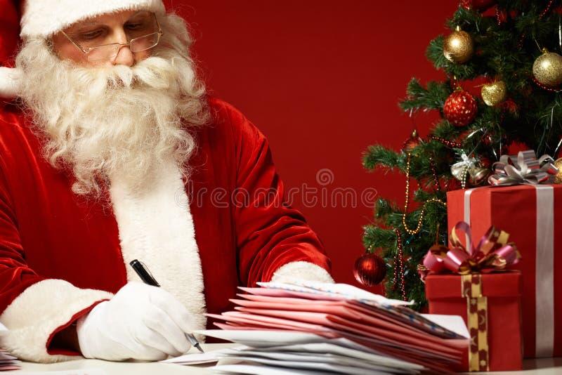 Het schrijven Kerstmiswensen stock foto's