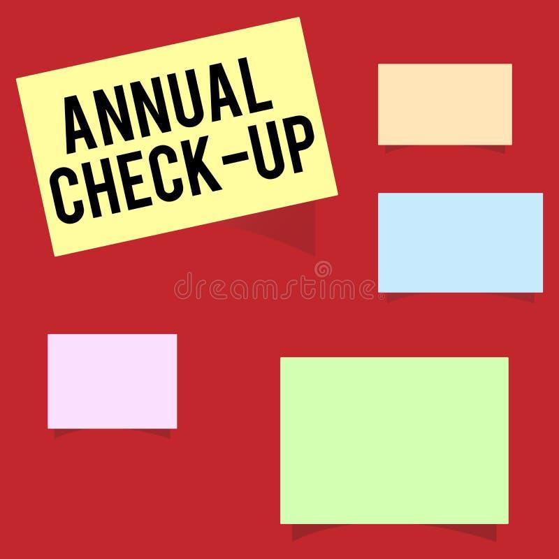Het schrijven nota die Jaarlijkse Controle tonen De bedrijfsfoto die jaarlijks evaluatie en onderzoek van het aantonen van s demo royalty-vrije illustratie