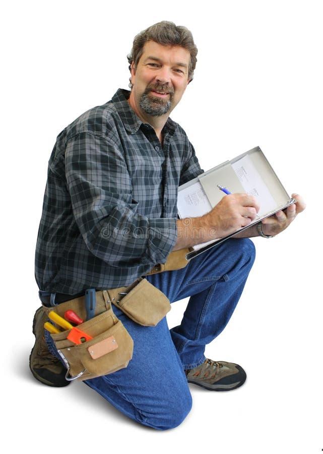 Het schrijven van de arbeider stock afbeeldingen