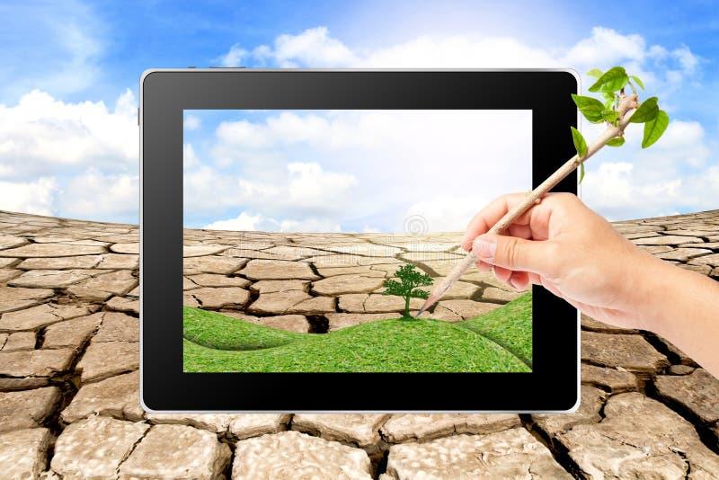 Het schrijven van de hand denkt Groene Ecologie op tablet stock afbeelding