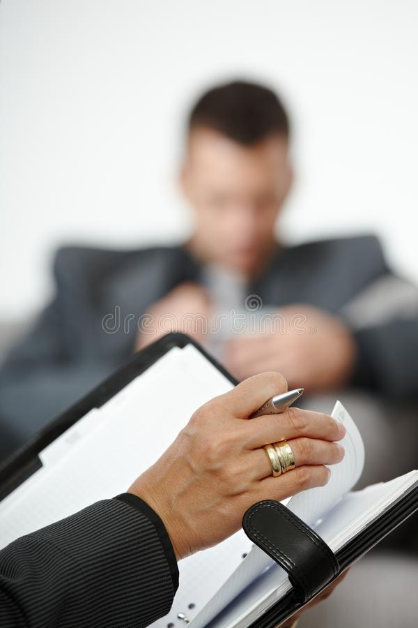 Het schrijven van de hand nota's stock fotografie