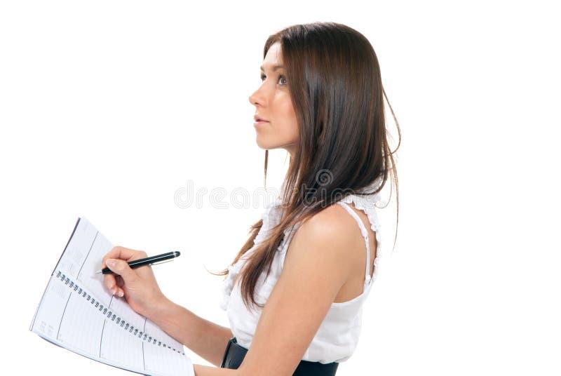 Het schrijven van de vrouw, neemt nota's, handboeknotitieboekje stock foto's
