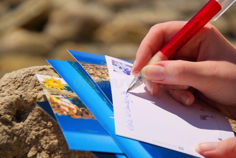 Het schrijven van een beeldprentbriefkaar royalty-vrije stock foto's