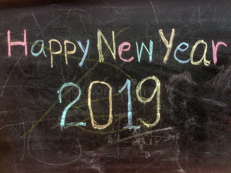 Het schrijven van Gelukkig Nieuwjaar op bord royalty-vrije stock afbeelding