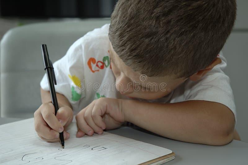 Het Schrijven van het kind stock foto