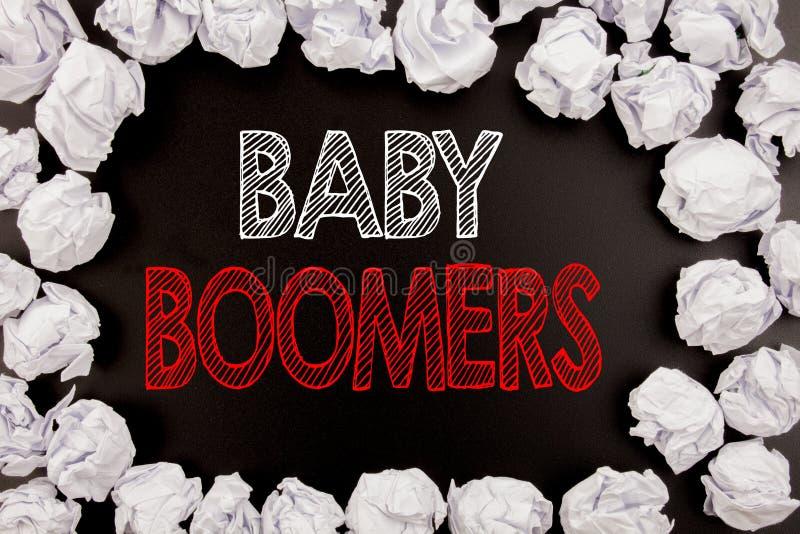 Het schrijven van tekst die Baby Boomers tonen Bedrijfsconcept voor Demografische die Generatie op zwarte achtergrond met exempla royalty-vrije stock foto's
