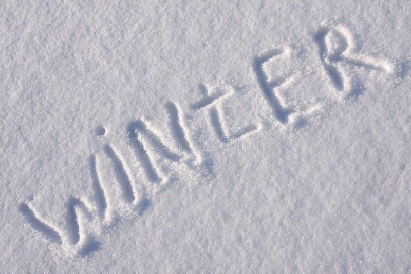Het schrijven van tekst op de sneeuw stock afbeelding