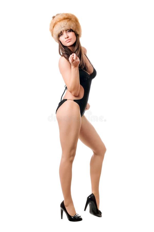 Het sexy vrouw stellen in zwempak en bont-GLB royalty-vrije stock foto's