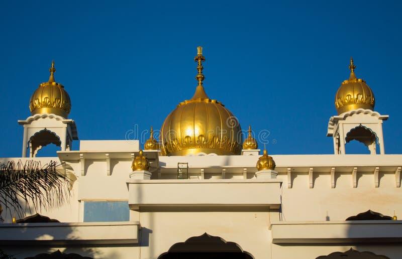 Het sikh schijnsel van tempel gouden koepels in de zon royalty-vrije stock foto's