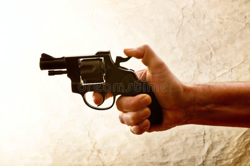 Het silhouet van a bemant hand met een pistool royalty-vrije stock afbeelding