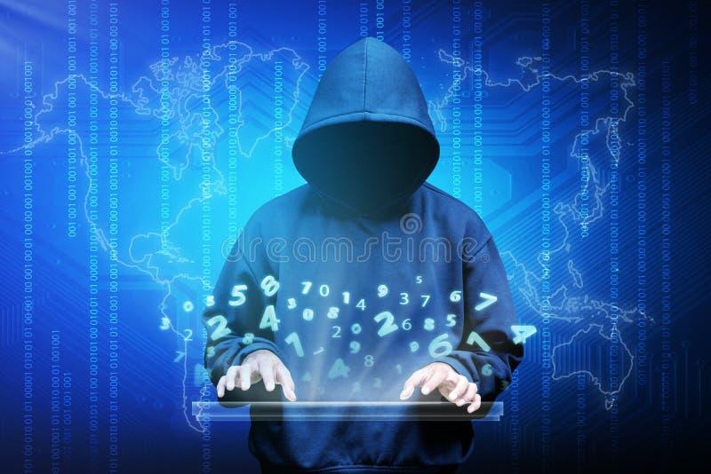 Het silhouet van de computerhakker van de mens met een kap stock foto
