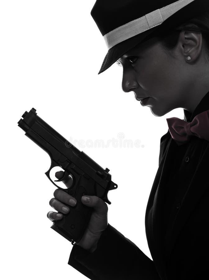 Het silhouet van de de gangstermoordenaar van het vrouwenkanon royalty-vrije stock foto's