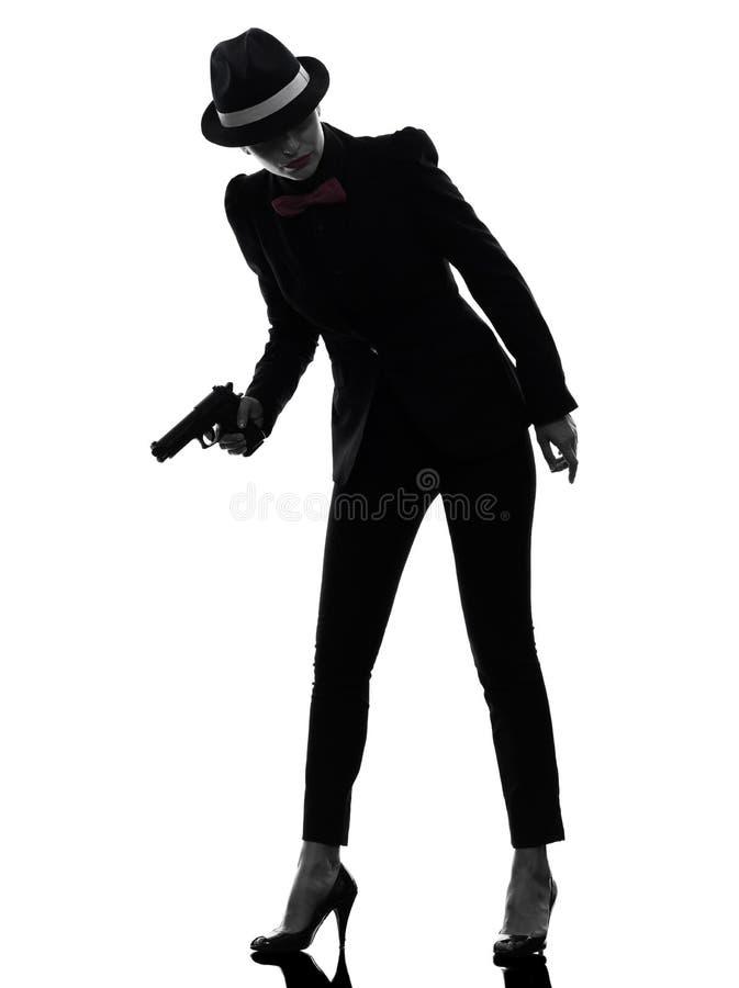 Het silhouet van de de gangstermoordenaar van het vrouwenkanon stock foto