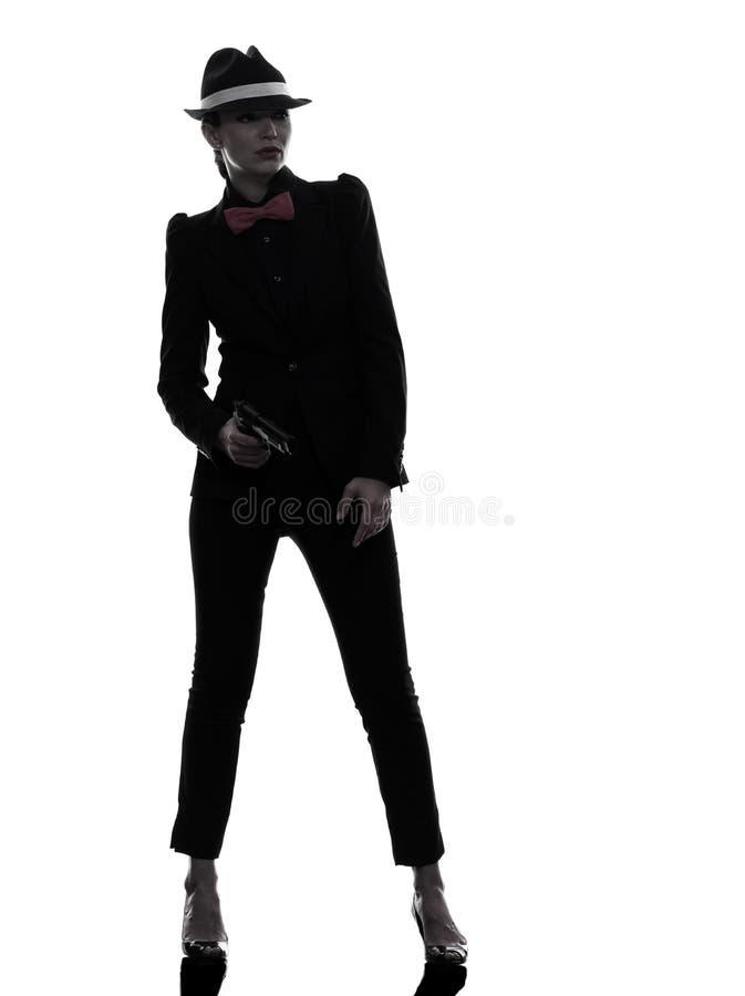 Het silhouet van de de gangstermoordenaar van het vrouwenkanon stock fotografie