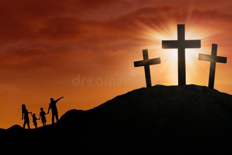 Het silhouet van de familie bij het Kruis vector illustratie