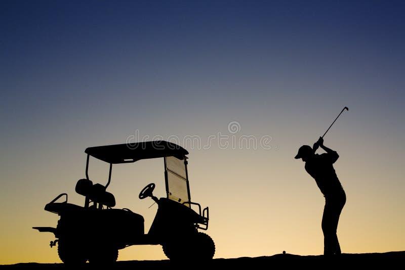 Het Silhouet van de golfspeler stock foto's
