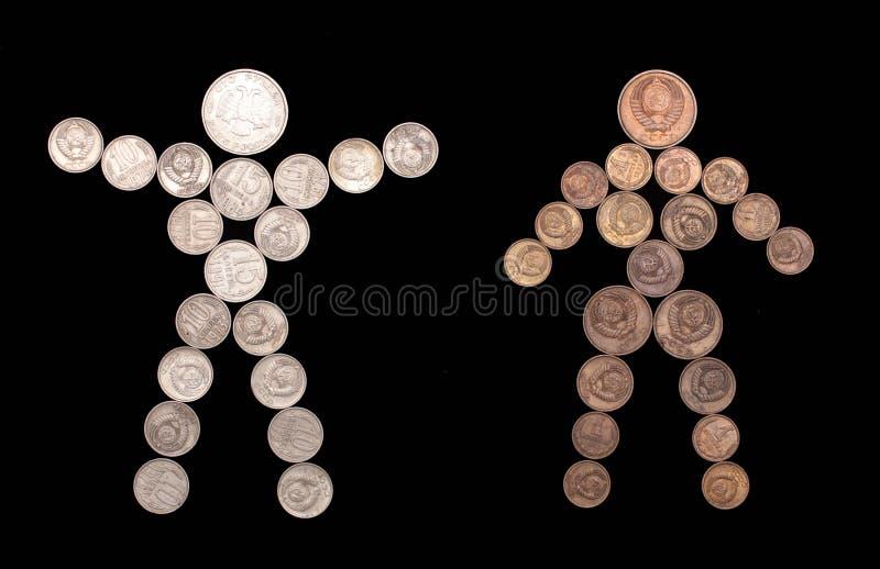 Het silhouet van de man en van de vrouw van muntstukken royalty-vrije stock foto