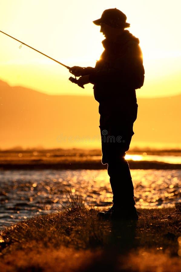 Het silhouet van de visser royalty-vrije stock afbeeldingen