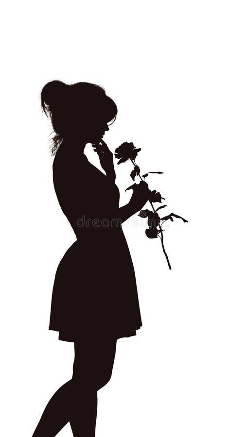Het silhouet van een jonge elegante vrouw in een kleding en met nam in handen, cijfer toe van slank mooi meisje met een bloem op  stock foto's