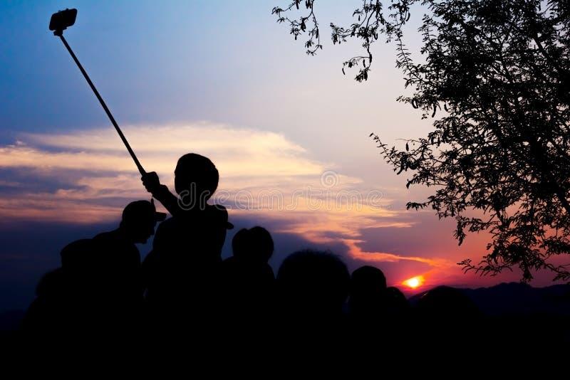 Het silhouet van Reizigers geniet van stock foto's