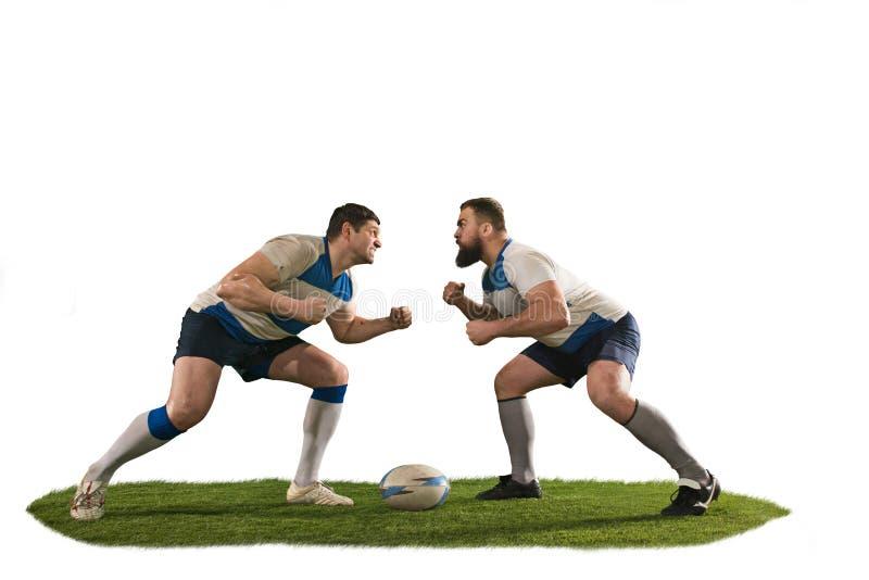 Het silhouet van twee de Kaukasische die speler van de rugbymens op witte achtergrond wordt geïsoleerd royalty-vrije stock foto's
