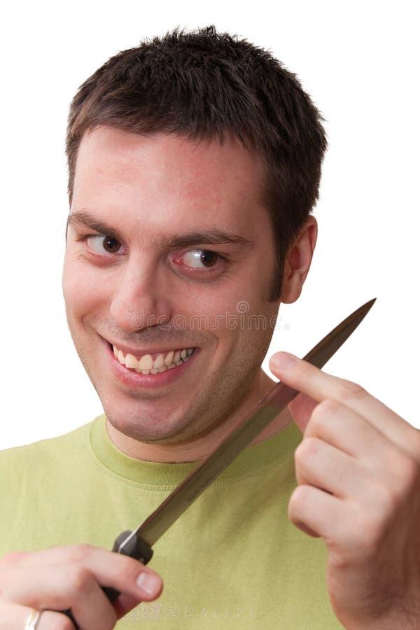 Het sinistere kijken mens met mes stock afbeelding