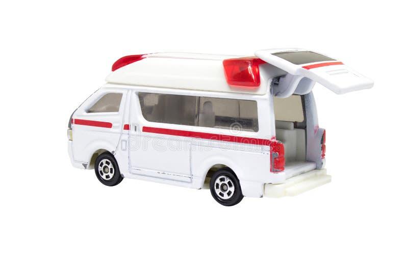 Het sjofele modeldiestuk speelgoed van de ziekenwagenauto op witte achtergrond wordt geïsoleerd royalty-vrije stock afbeelding