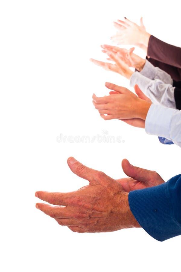 Het Slaan van handen stock afbeelding