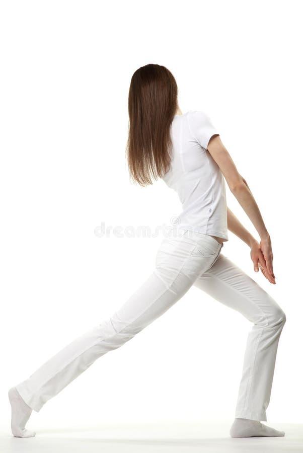Het slanke jonge vrouw uitoefenen stock afbeelding