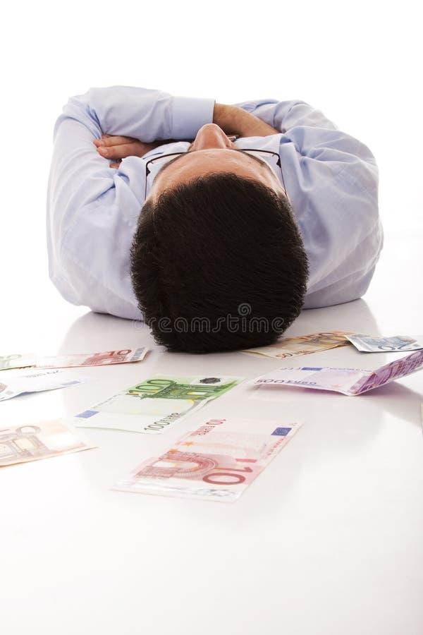 Het slapen met het geld royalty-vrije stock fotografie