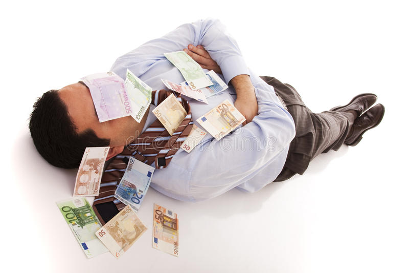 Het slapen met het geld royalty-vrije stock afbeeldingen