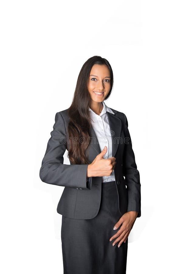 Het slimme jonge onderneemster geven duimen omhoog royalty-vrije stock afbeelding