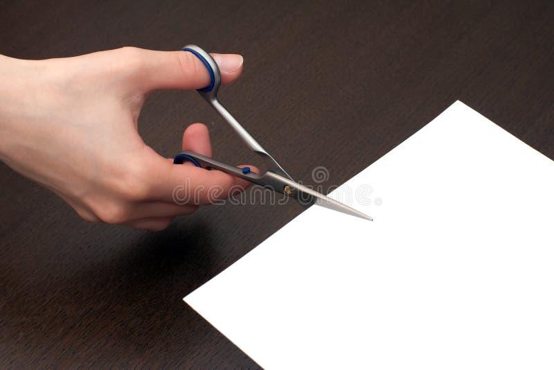 Het snijden van het document stock fotografie
