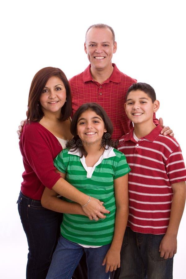 Het Spaanse familie glimlachen geïsoleerd op wit royalty-vrije stock foto