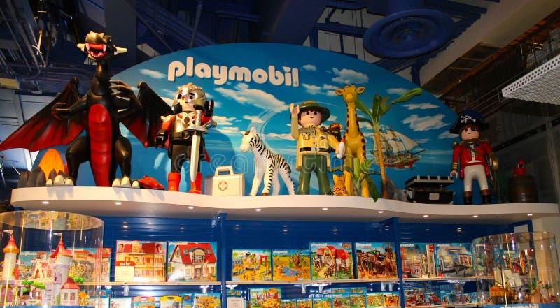 Het speelgoedmening van de Playmobilinzameling, de stad die van New York, de V.S. winkelen stock foto