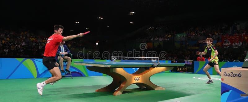 Het speelpingpong van Zhang Jike bij de Olympische Spelen in Rio 2016 royalty-vrije stock fotografie