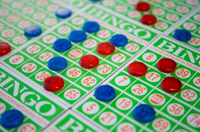 Het speelspel van bingokaarten stock afbeeldingen