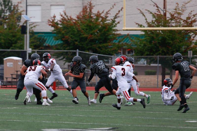 Het Spel van de middelbare schoolvoetbal stock foto