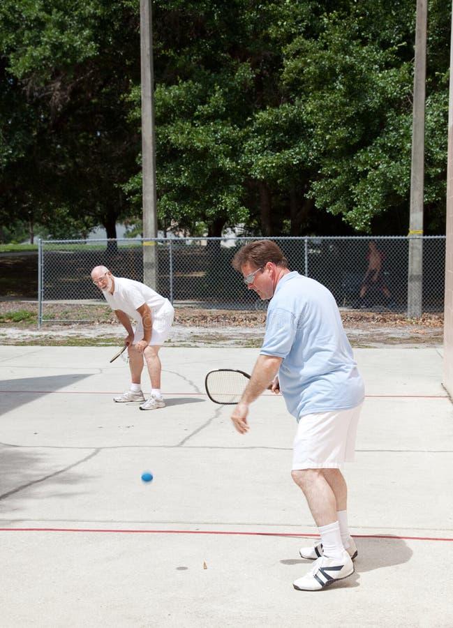Het Spel van het Racketball van de familie stock fotografie